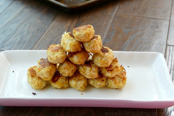 Cauliflower Tots recipe stacked on a white plate