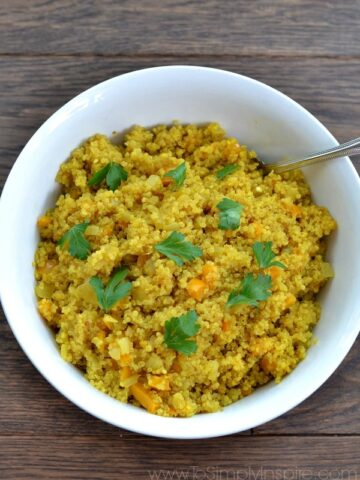 a bowl of Curried Quinoa recipe topped with cilantro pieces