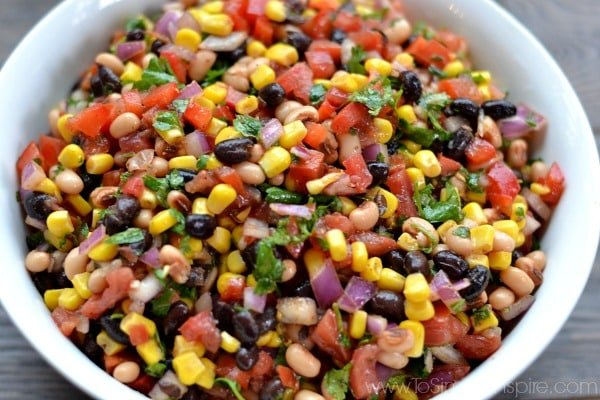 Cowboy Caviar is a colorful blend of fresh ingredients, beans, and mild spices with a touch of lime juice. Serve with your favorite chips for a fabulous, healthy appetizer.