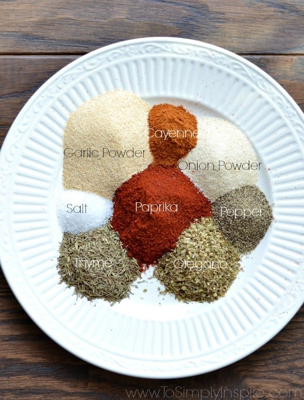 a white plate with piles of spices to make homemade emerils essence seasoning