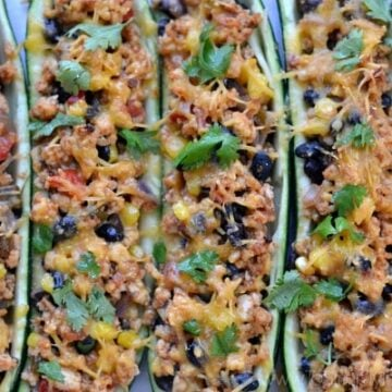 Closeup of Mexican Zucchini Boats with black beans and cilantro recipe in a casserole dish