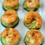appetizer with shrimp on top of cucumber and avocado