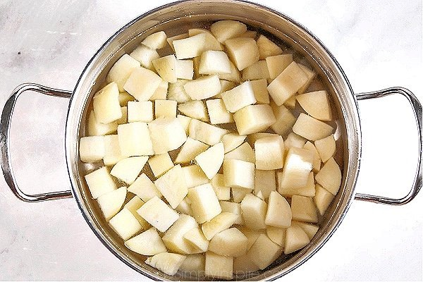 diced potatoes in a stainless steel pot