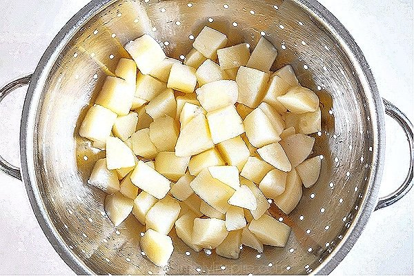 diced potatoes in a silver colander