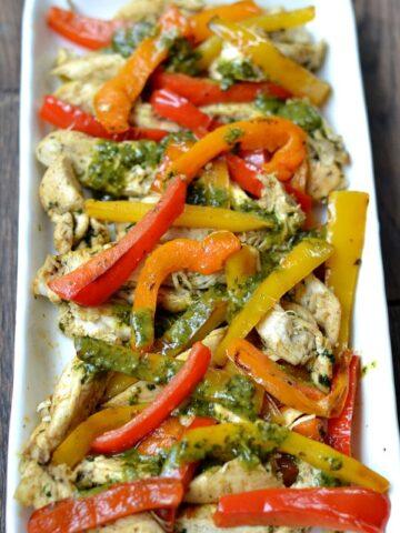 closeup of Cilantro Lime Chicken Fajitas recipe on a white rectangle plate.