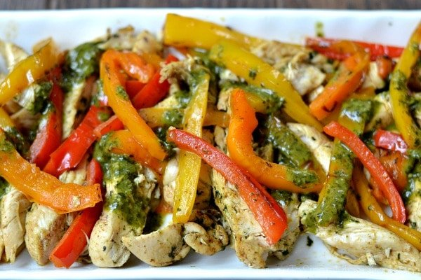 closeup of a plateful of Cilantro Lime Chicken Fajitas recipe with red and yellow bell peppers