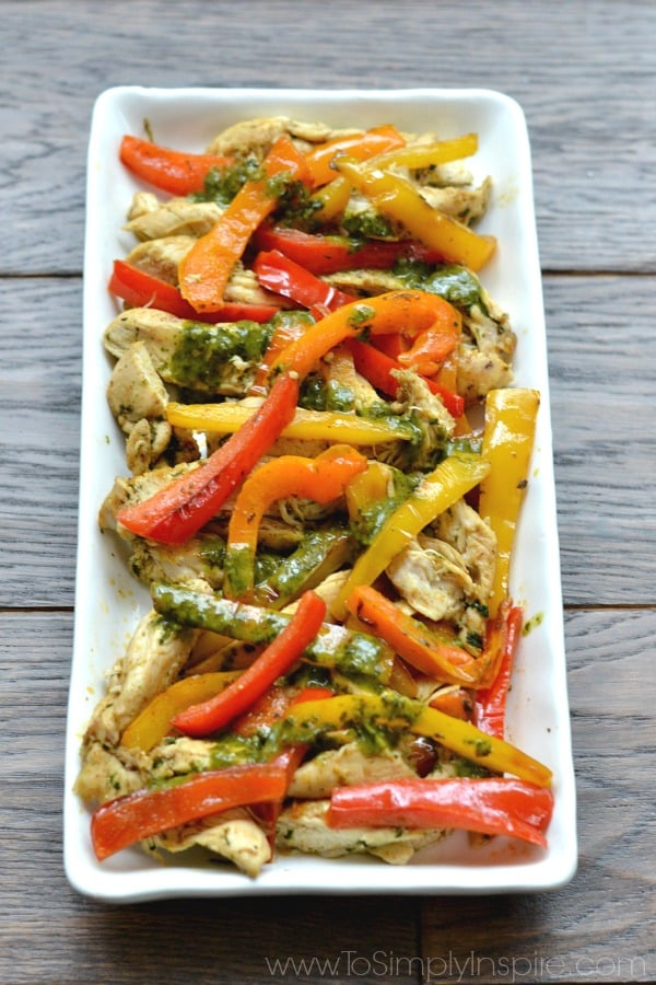 Cilantro Lime Chicken Fajitas with peppers recipe on a white plate.