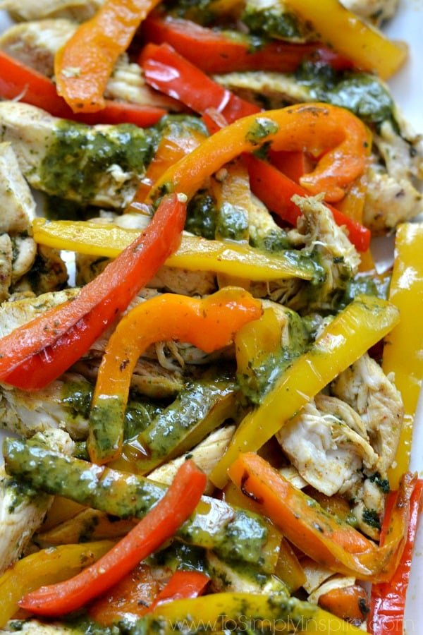 closeup of Cilantro Lime Chicken Fajitas recipe with red orange and yellow bell peppers