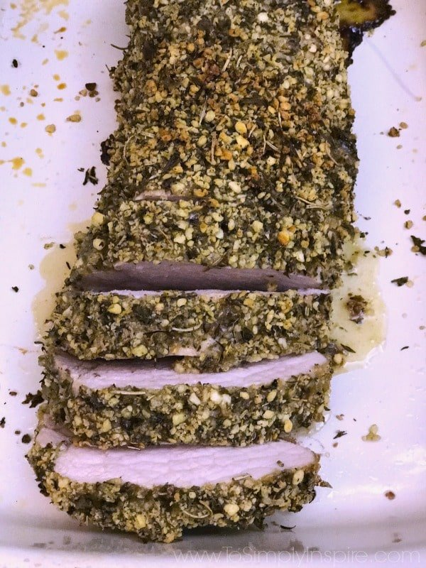 This juicy Herb Crusted Pork Tenderloin is perfectly seasoned with rosemary, thyme and dijon mustard combined with panko bread crumbs for a wonderful healthy meal.
