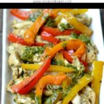 chicken fajitas with orange, yellow and red peppers on a white plate with text overlay