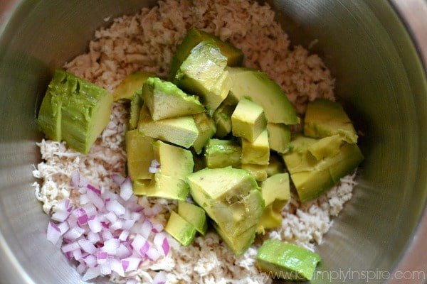 Ingredients for Avocado Chicken Salad in a stainless steel mixing bowl.