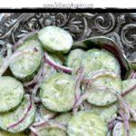 Creamy cucumber salad recipe in a silver bowl