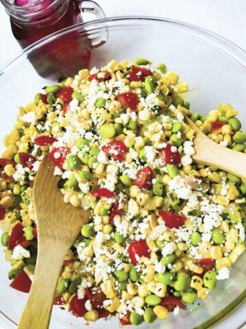 a closeup of Succotash Salad recipe in a glass bowl