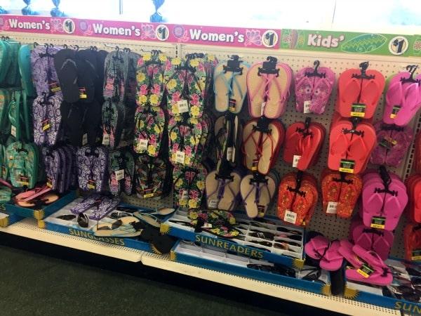 A store shelf display of flip flops
