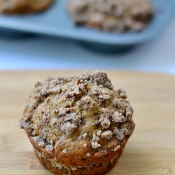A muffin sitting on top of a wooden table