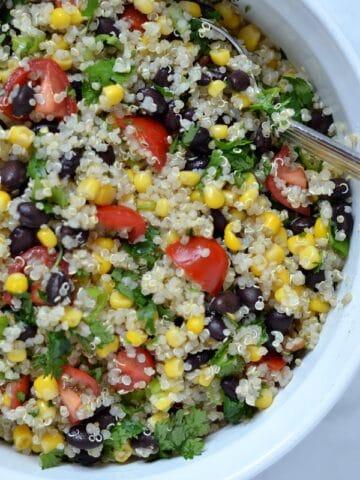 a closeup of Southwest quinoa salad recipe in a white bowl