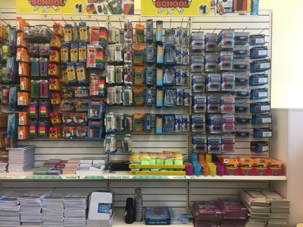 A close up of a store shelf of school supplies