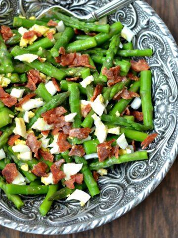 Asparagus Bacon and Egg Salad with Dijon Vinaigrette recipe in a big silver bowl