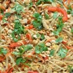 Chicken Pad Thai topped with cilantro and red bell peppers