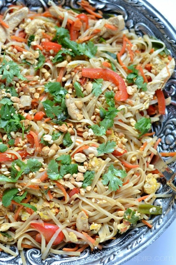 Closeup of Chicken Pad Thai recipe in a big silver bowl