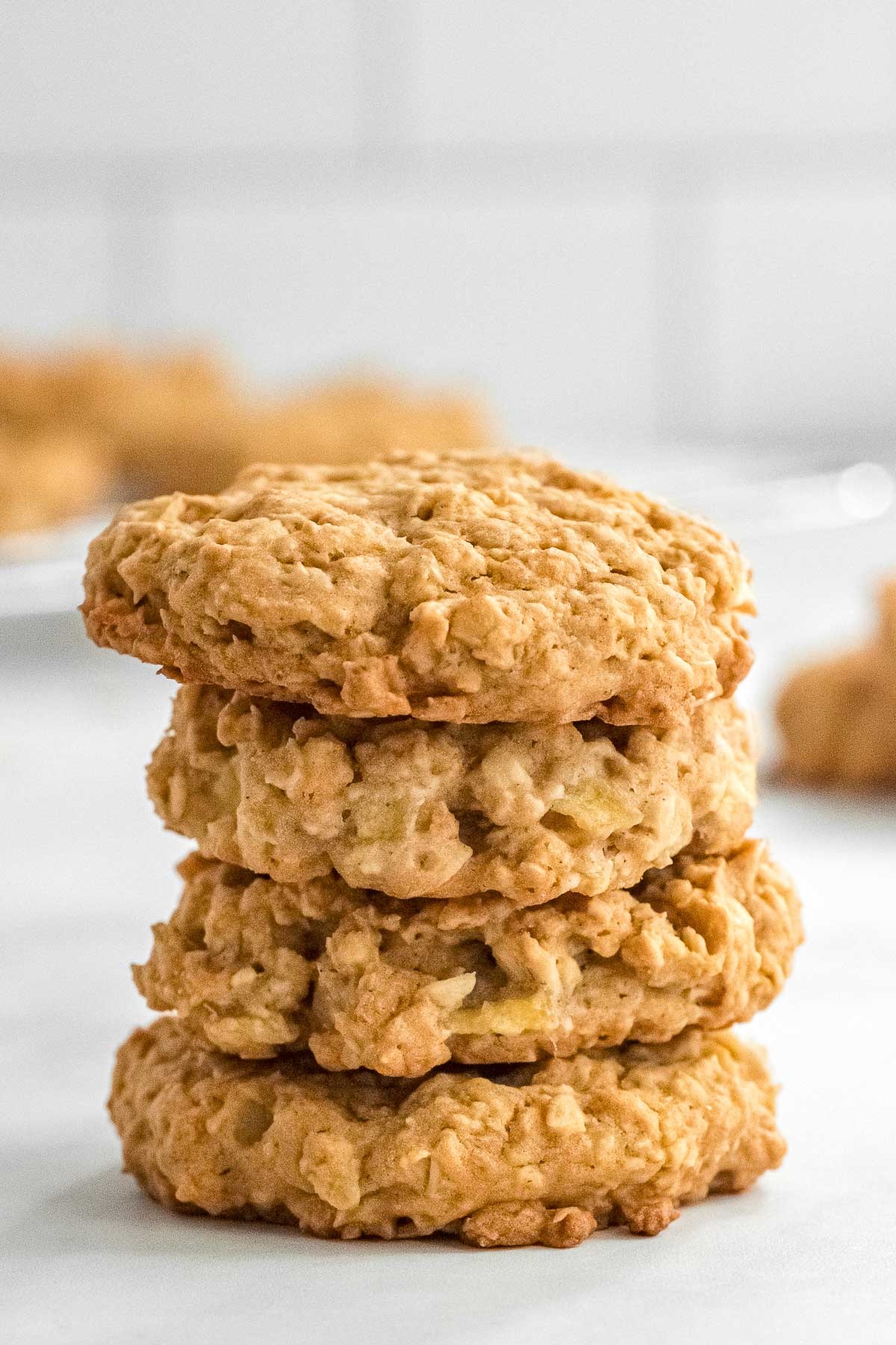 a stack of 3 Apple Pie Oatmeal Cookies on a white plate