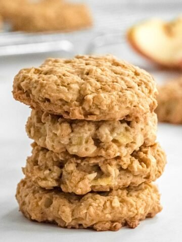 a stack of four apple oatmeal cookies