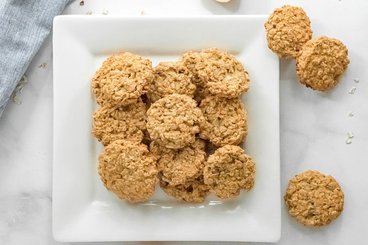 white square plate full of apple oatmeal cookies