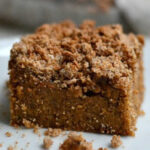 closeup of a piece of pumpkin coffee cake with crumb topping