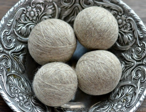 Learn how to make DIY wool dryer balls. Reduce static and save money by tossing them in with each dryer load. Scent them with your favorite essential oil.