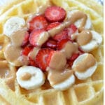 protein waffle recipe topped with strawberries and bananas
