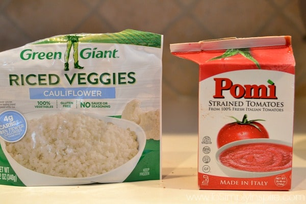 bag of green giant cauliflower rice and Pomi strained tomatoes on a counter
