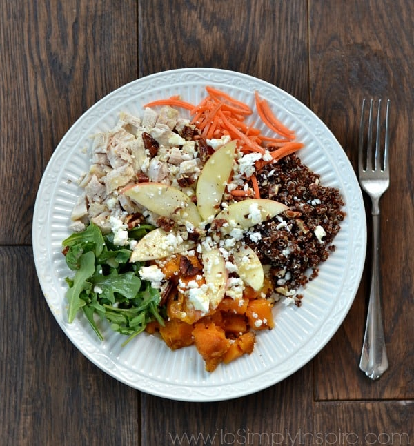 Quinoa Power Bowl withSweet potatoes, arugula, diced apple, red quinoa, feta, roasted pecans topped with honey dijon vinaigrette.