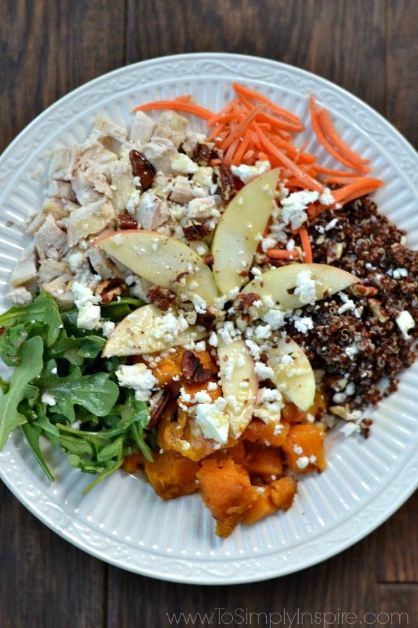 Quinoa Power Bowl - Sweet potatoes, arugula, diced apple, red quinoa, feta, roasted pecans topped with honey dijon vinaigrette.