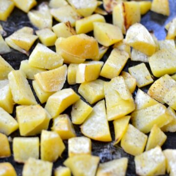 roasted turnips cubes on a baking sheet