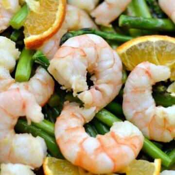 A pile of shrimp and asparagus