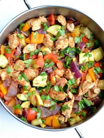 closeup of Mexican Chicken Zucchini Skillet recipe in a stainless steel pan