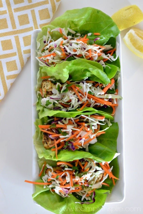 These Lemon Herb Chicken Lettuce Wraps with Citrus Slaw are a wonderful, light and easy lunch or dinner idea. Ready in less than 30 minutes with the perfect amount of zesty and crunchy flavors.