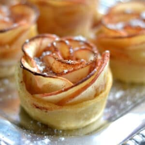 a tray of apple rose puff pastries