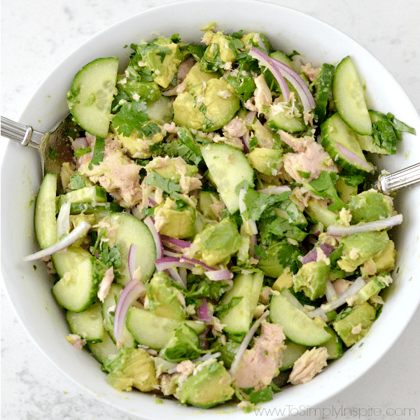 Avocado Tuna Salad recipe mixed in a bowl on a white counter