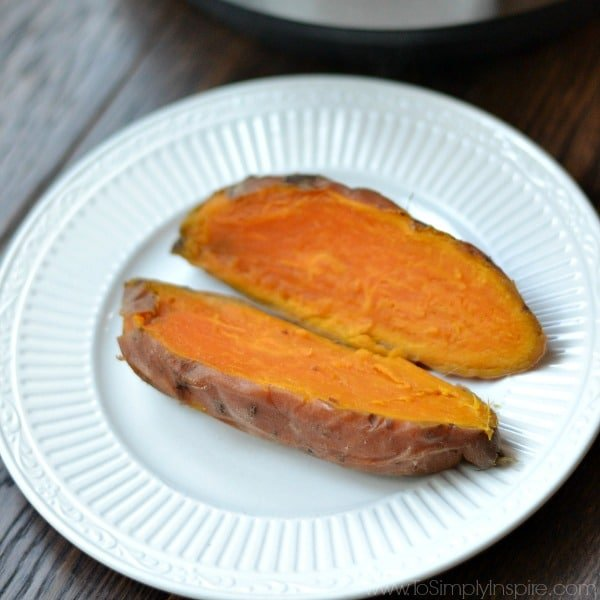 Sweet potato cut open on white plate
