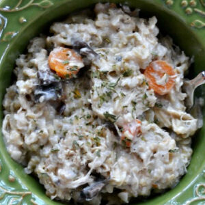 creamy chicken and rice casserole in a green bowl