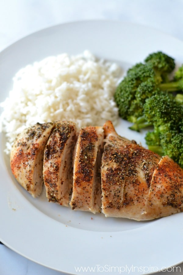 Baked Chicken Breasts on a plate with rice and broccoli - Recipe at To Simply Inspire
