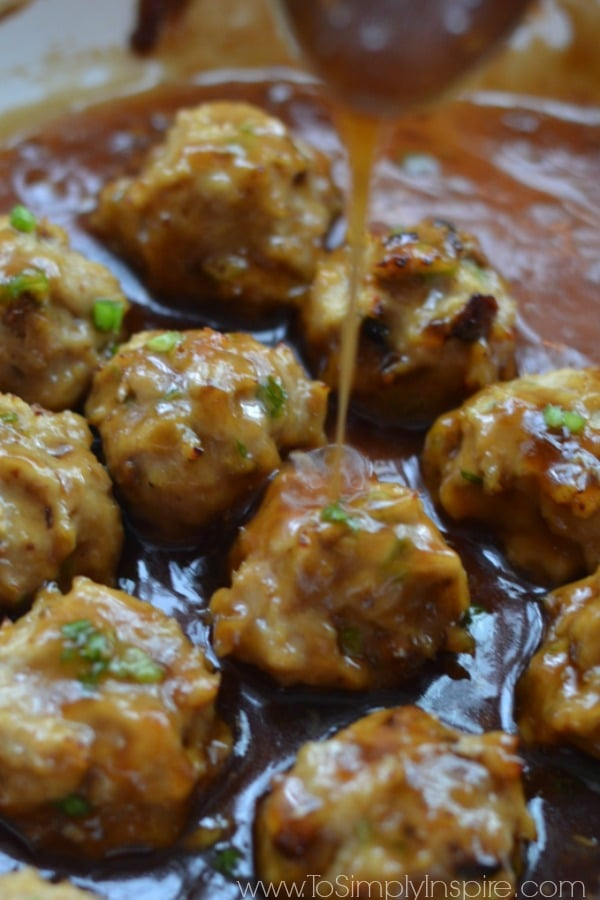 Closeup of Teriyaki Chicken Meatballs Recipe with sauce being poured over top.