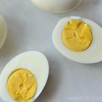 Closeup of cut hard boiled egg with yolk showing
