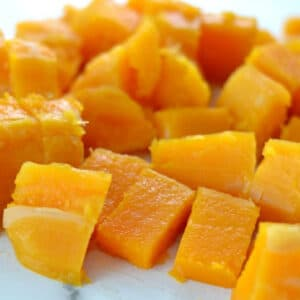 closeup of cooked butternut squash cut into cubes