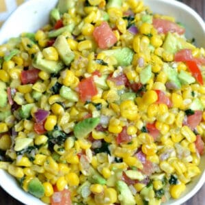 closeup of corn salsa in a white bowl