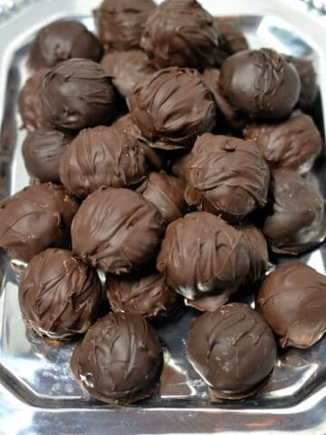peanut butter balls on a silver tray