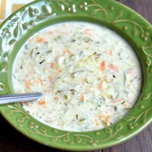 creamy zucchini soup in a green bowl