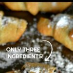 crescent roll filled with nutella spread and topped with powdered sugar with next overlay