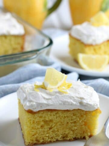 A close up of a slice of lemon cake on a plate